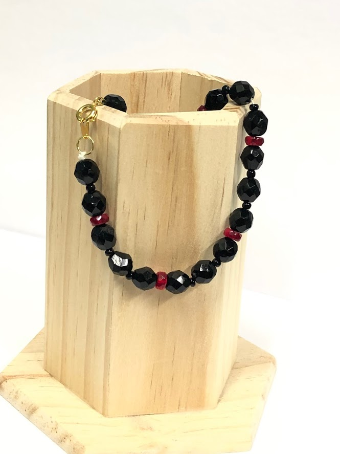 bracelet with black and red beads