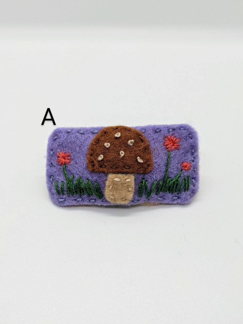 brown mushroom on purple background with embroidered flowers