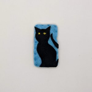 black cat with yellow eyes on blue background