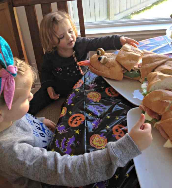 Fast Halloween party planning with a Halloween menu that includes a fun snake shaped sandwich.