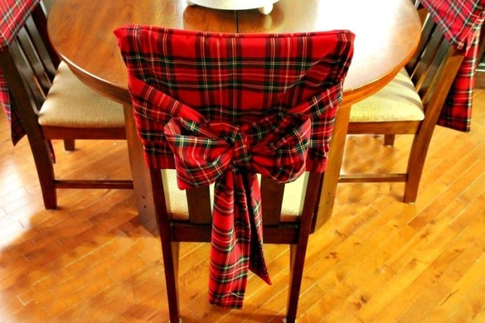 A DIY hand made chair cover for Christmas decor. This chair cover has a bow sash.