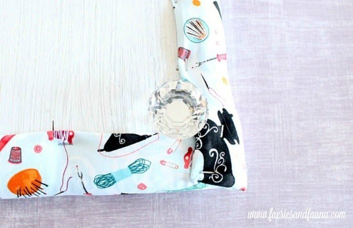 DIY ironing board for a craft table with a pretty clear acrylic sparkly feminine knob for the legs.