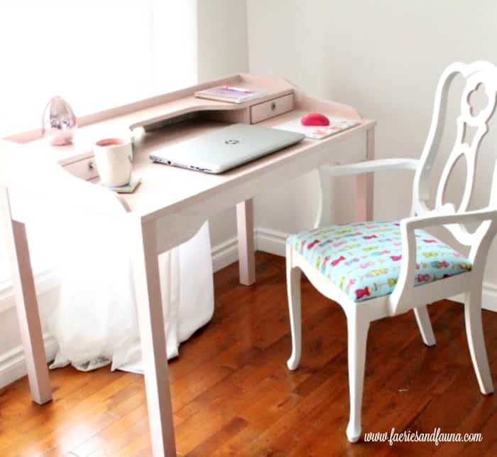 Chalk painted desk in blush pin that has received a furniture refinishing.