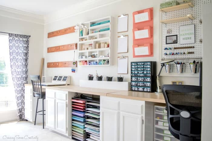 A organized craft room for scrap booking with a long counter and lots of craft storage ideas. Craft room ideas, craft room ideas on a budget, hobby room idea, sewing room idea, craft area ideas,craft room inspiration, home office craft room ideas.