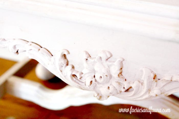 Antique wood scrolling refinished in blush pink and repaired.