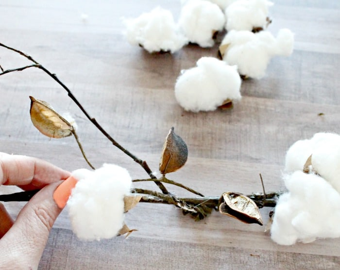 Attaching handmade cotton bolls to branches. DIY cotton branches, cotton pod, DIY cotton stems, DIY cotton balls DIY, art and craft, DIY crafts, cotton branches, cotton craft, cotton ball crafts,
