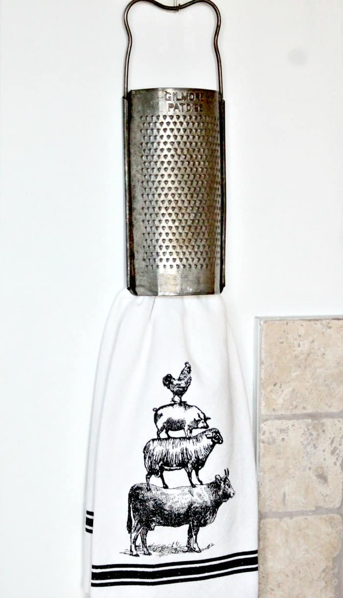An antique grater used for a towel rack in a farmhouse decors kitchen. farmhouse kitchen, farmhouse style kitchen, farm style kitchen,farmhouse kitchen accessories