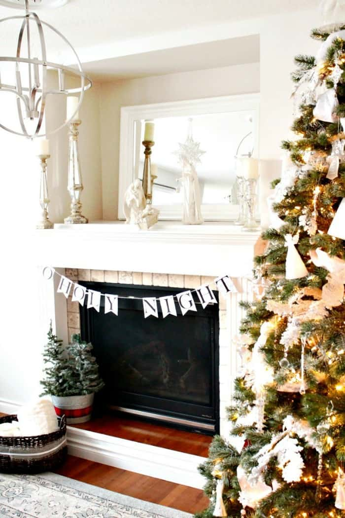 How to make a DIY faux fireplace. This white fireplace is perfect for Christmas decorating or fall decor.