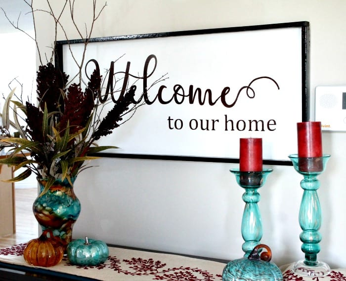 A fall decor idea including a large DIY Welcome Sign. A farmhouse saying sign using wood.