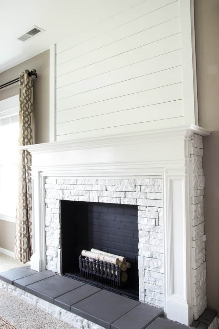 DIY Faux fireplace in white with a mantel. Very pretty for fall decorating or Christmas decor.