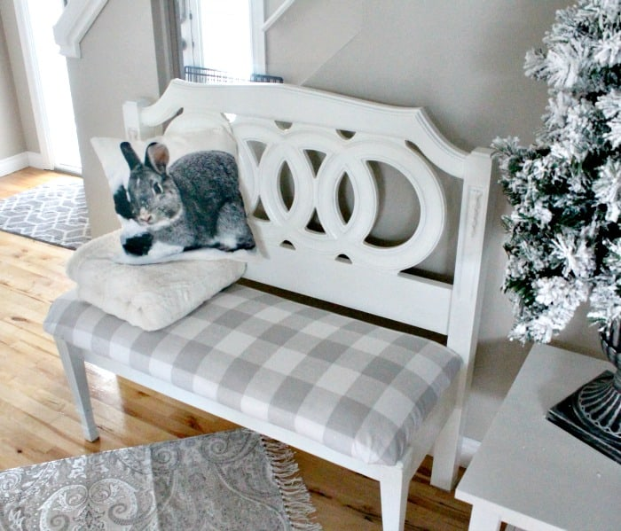 A pretty white farmhouse style bench that was made from a headboard. Headboard bench ideas, diy bench seat, diy headboard bench, how to make a bench from a headboard