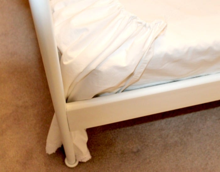 The tucked in corner of a DIY bed skirt. It is easy to make and inexpensive bedskirt.