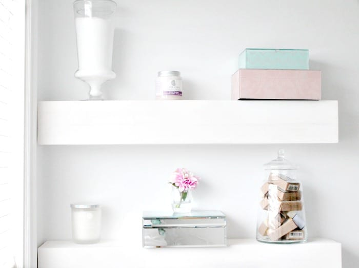 White DIY floating shelf for the bathroom for organization ideas.