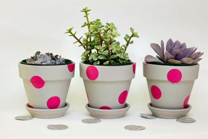 Pink polka cotted and decorated clay pots.