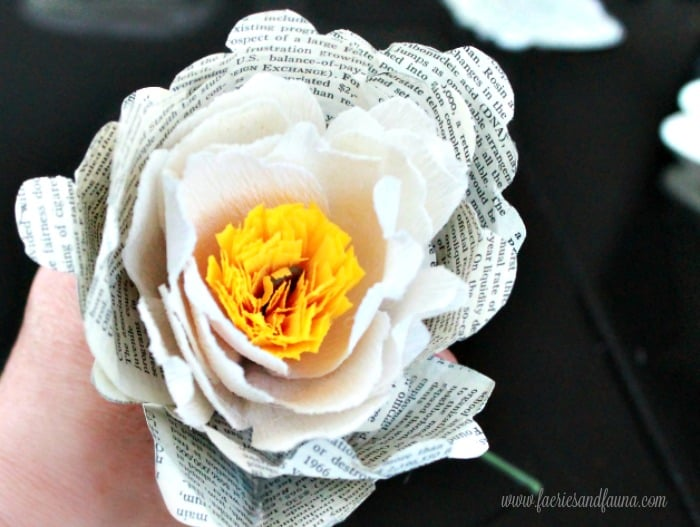 The first two layers of a large crepe paper peony, with the center, and blossoms. Flower making, how to make paper flowers, flower making with crepe paper, minimalist wreath, elegant wreath, diy wedding decor, paper flowers wedding, book page crafts.