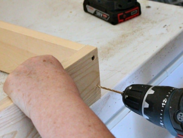 Predrilling lumber before attaching with screws on a DIY scrap wood flower box. A pallet wood flower box for the back yard, DIY Wood Planter Plan, DIY flower box DIY planter, mod podge projects, mod podge crafts