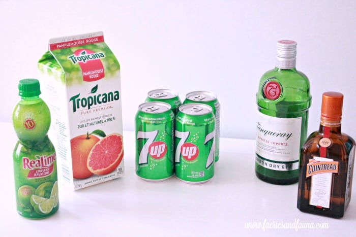 Ingredients for a frozen alcoholic drink beverages, including gin, Cointreau, grapefruit juice, 7-Up and Lime juice