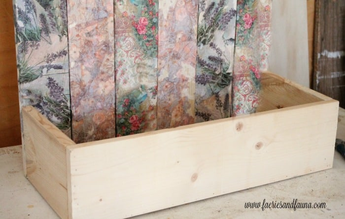 A DIY flower box. The front piece are attached to the much taller back piece. A pallet wood flower box for the back yard, DIY Wood Planter Plan, DIY flower box DIY planter, mod podge projects, mod podge crafts