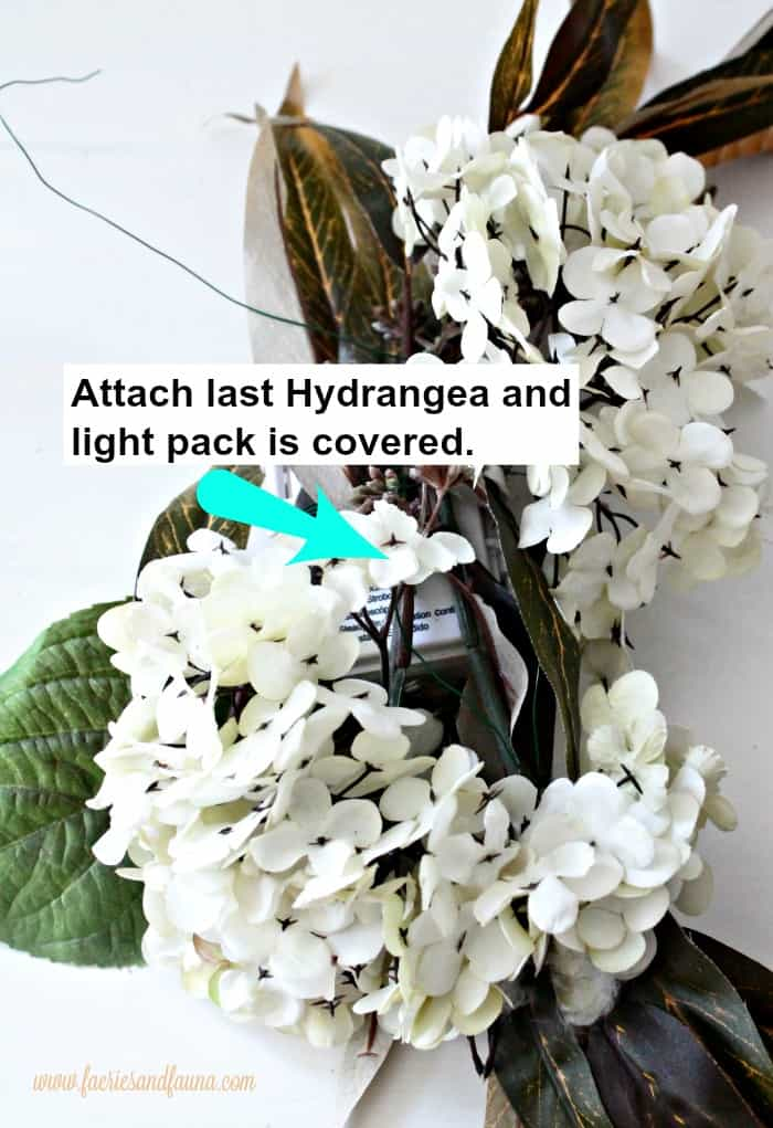 How to make a wreath and camouflage a battery pack using flowers on a wreath