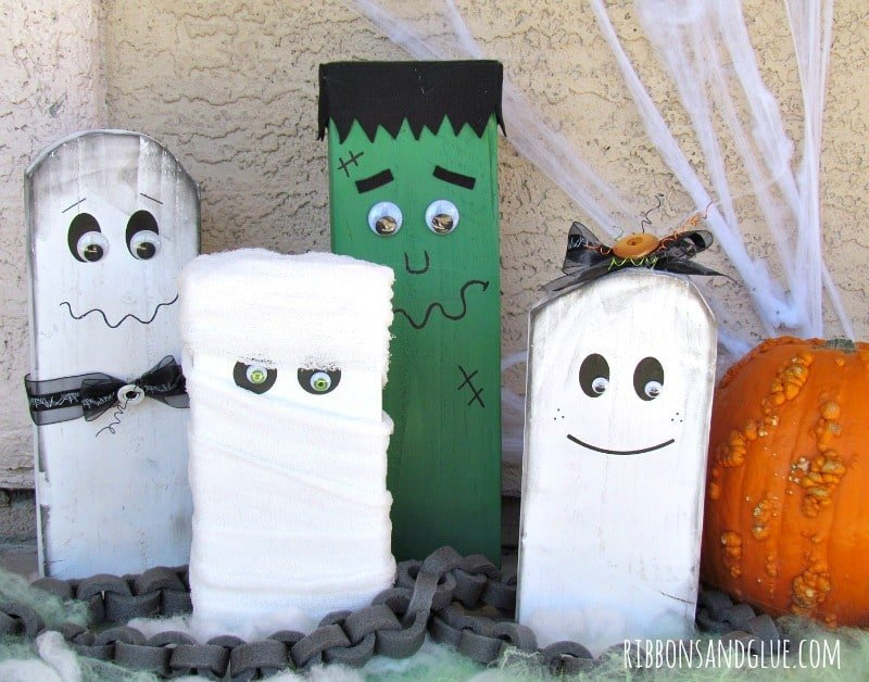 DIY wood craft project for Halloween, A Halloween family with ghosts, mummy and frankenstein.