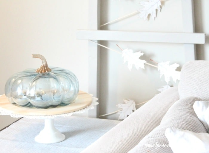 A DIY fall banner made with paper leaves and twine.