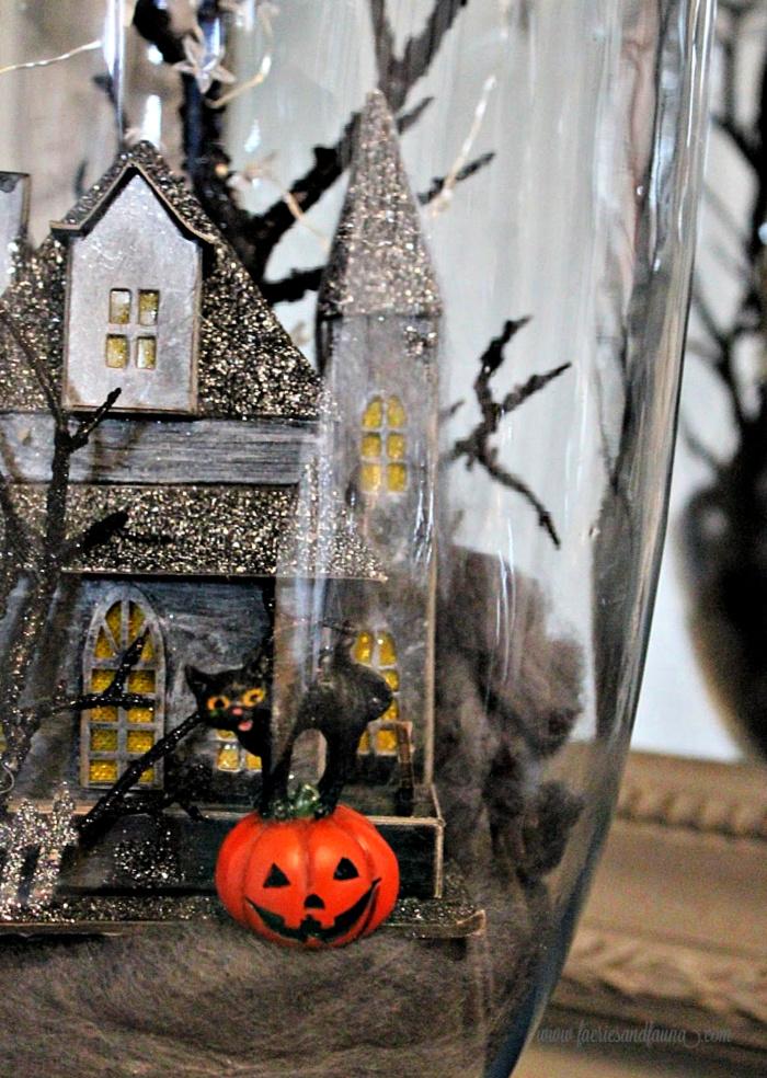 Haunted house Halloween Apothecary jar arrangement.