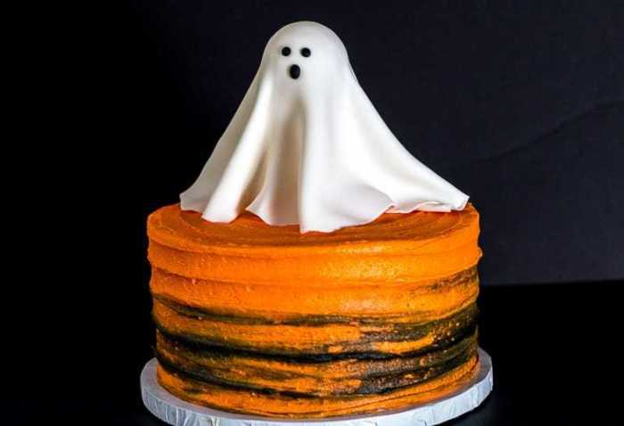 Naked cake with large fondant glowing ghost on top for a Halloween treat.