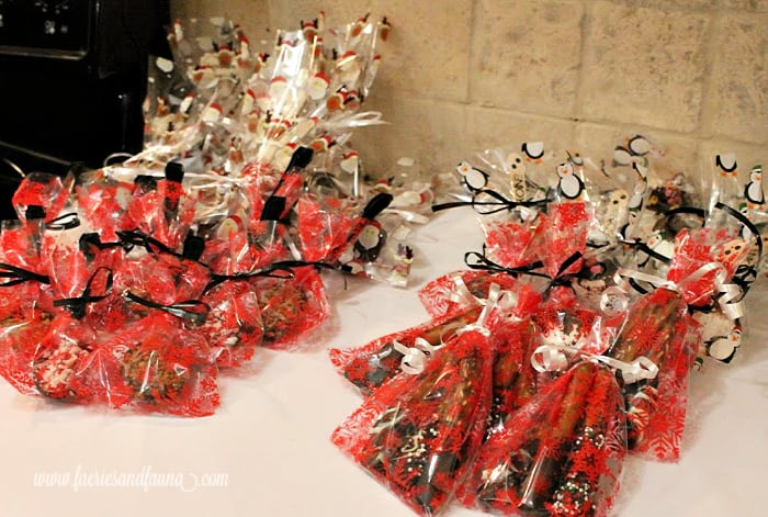 Fancy wrapping for chocolate candies being placed in Christmas mason jars.