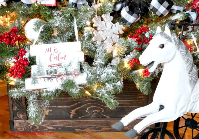 A DIY Wood tree stand as part of a farmhouse Christmas tree.