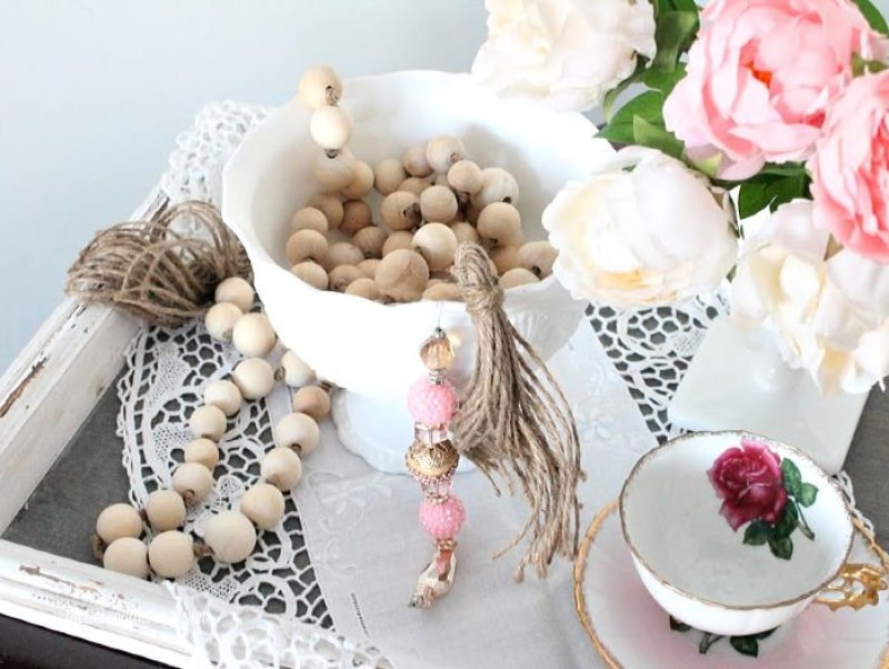 A valentine decor arrangement with a DIY farmhouse wood bead garland with tassels and extra bling.