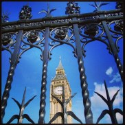 Big Ben as seen through the fence surrounding the Houses of Parliment