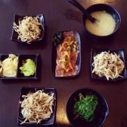 Miso soup, bean sprout and seaweed salads and beef tataki at Watari.