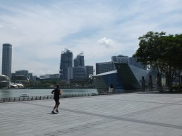 A jogger runs along the promenade outside the Shoppes at Marina Bay Sands - crazy man!