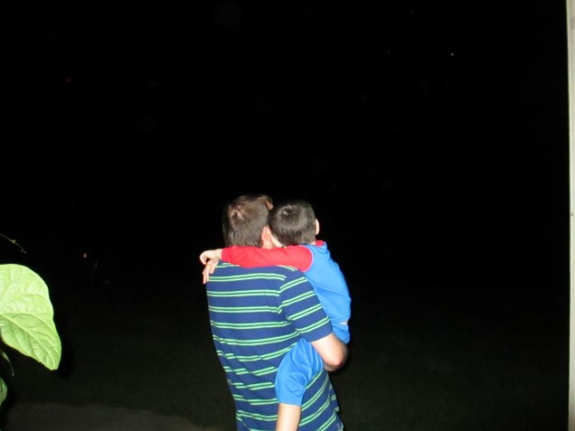 My husband taking my son out to see eclipse that was also a blood moon.