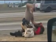 officer as Daniel L. Andrew pounding Marlene Mardella Pinnock , a grandmother, for jaywalking