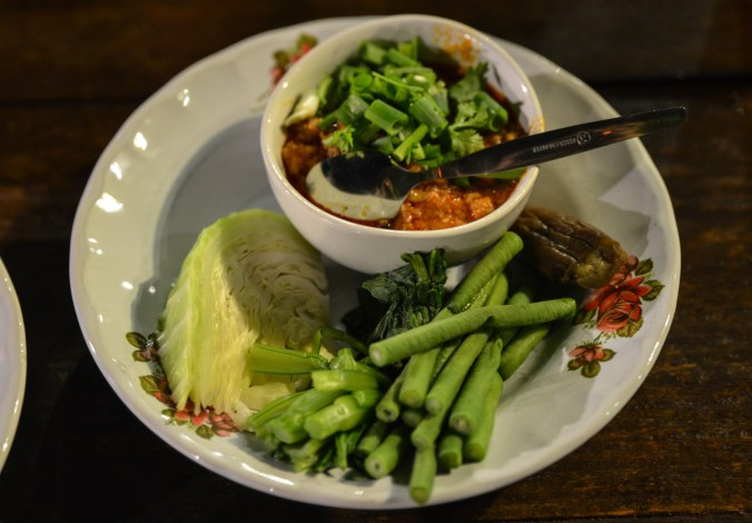 "Nam phrik (Thai dip or ""salsa) with tomato and eggplant."