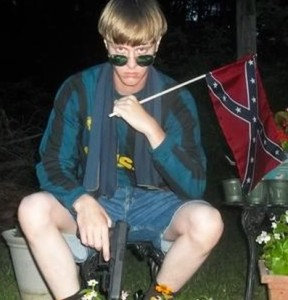 Dylann Roof with gun and Confederate flag
