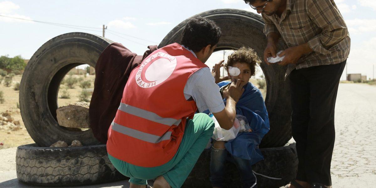 Victim receiving medical treatment (Photo: Delil Souleiman/AFP/Getty Images)