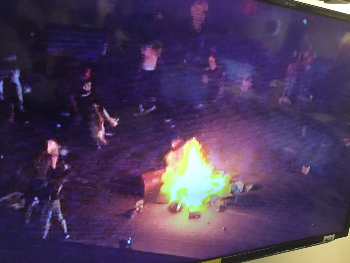 Protesters set fire to cargo (image: Joe Bruno/WSOC)
