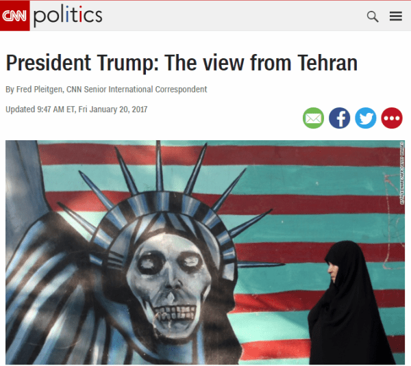 CNN photo of woman in chador by anti-American mural