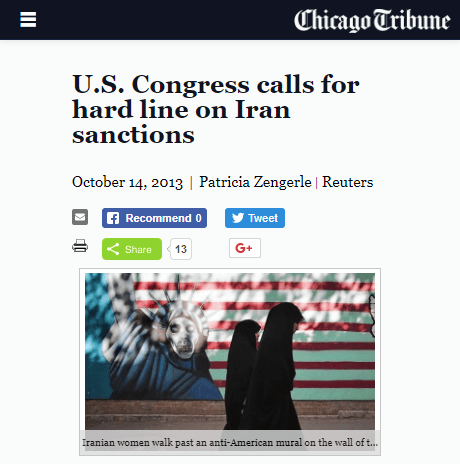 Chicago Tribune photo of women in chadors with anti-American mural