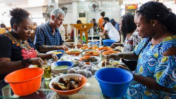 Anthony Bourdain with diners in Lagos, Nigeria