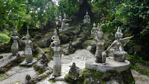 These statues say hi at Magic Garden.
