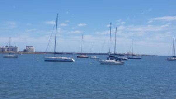 The yachts anchored in the bay.