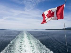 Canada Flag and ship wake