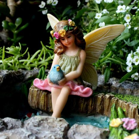Fairy Vicky sitting on a log 4