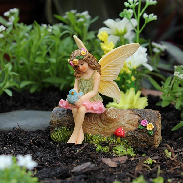 Fairy Vicky sitting on a log