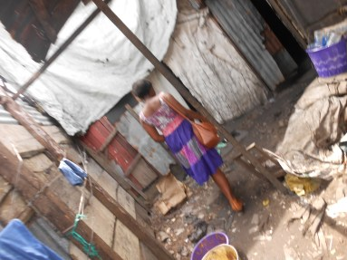 Ifeoma goes to Dustbin Estate
