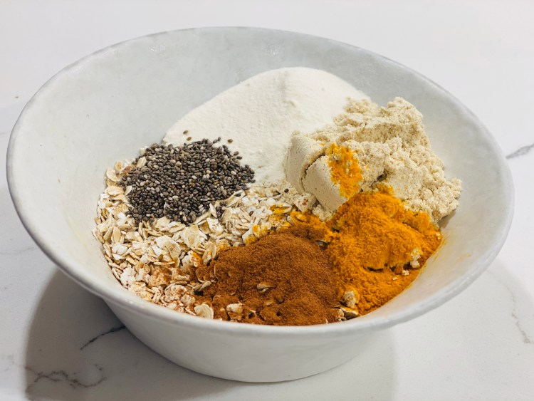 Overnight oats with collagen protein, tumeric, cinnamon, chia, and pumpkin spice protein powder.