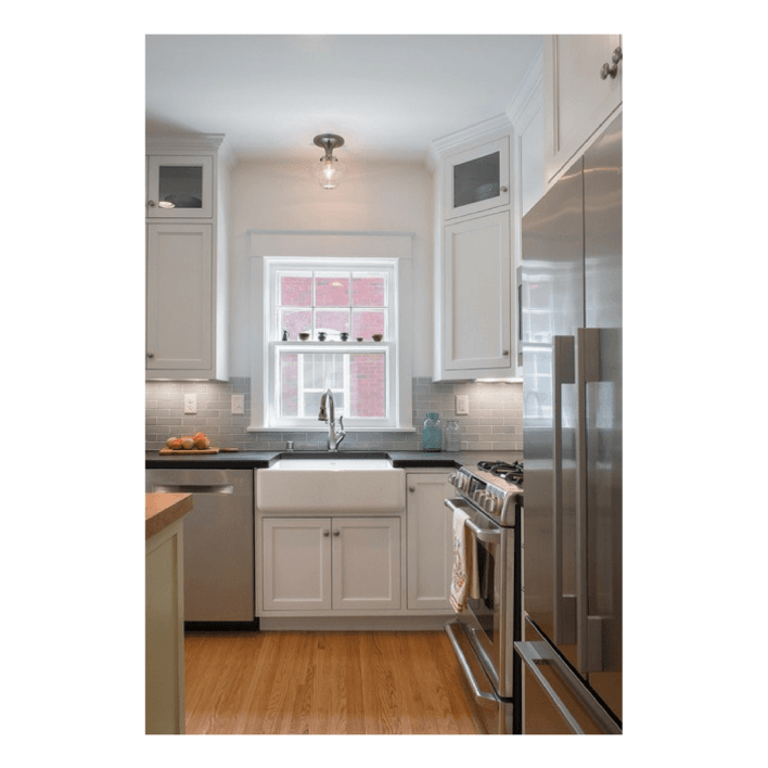 White + Stainless Kitchen with eco-friendly PaperStone countertops | Fairly Southern